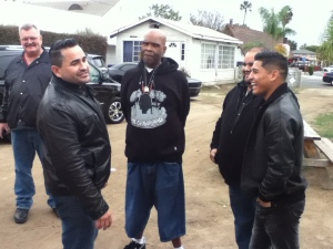 "Rives Mansion owner Ralph Verdugo (left) converses with radio personality Kurt ""Big Boy"" Alexander (center) and professional boxer Abner Mares (right) during the lemonade stand fundraiser on Friday. Alexander and Mares, as well as local dignitaries, attended the event to help aid the typhoon relief effort in the Philippines."
