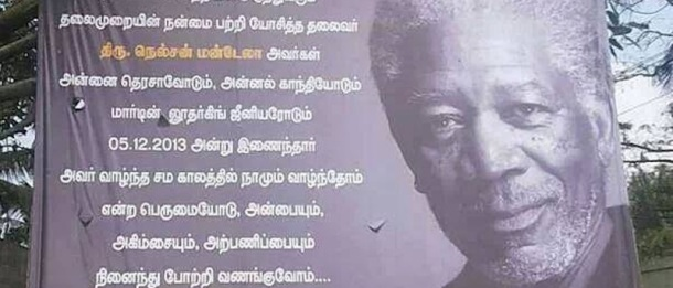 A billboard in a town in India honors the late Nelson Mandela, using an image of Morgan Freeman.